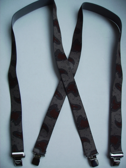 "CAMOUFLAGE 1 1/2""X48"" Suspenders with 4 strong 1""x 1"" Grips and 2 Length Adjusters in the front, all in NICKEL FINISH.   Entirely Stretchable Cotton/Polyester Material.         UB220N48DSST"