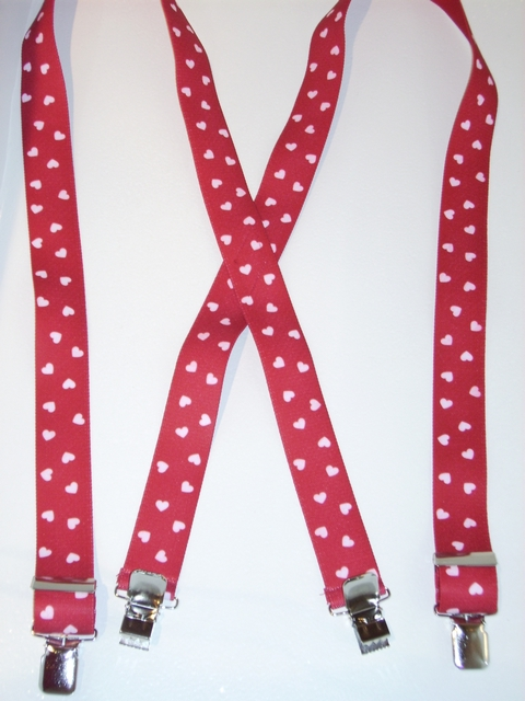 "White Hearts on Red BackgroundBackground 1 1/2""X48"" Suspenders with 4 strong 1""x 1"" Grips and 2 Length Adjusters in the front, all in NICKEL FINISH.   Entirely Stretchable Cotton/Polyester Material.          UB220N48VARE"