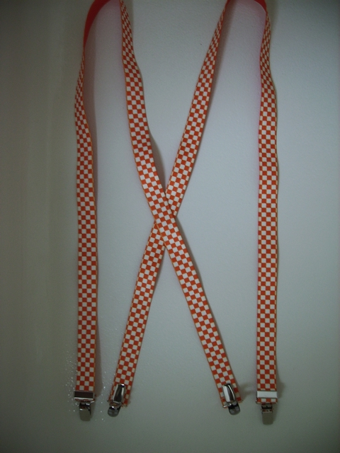 "CHECKERS ORANGE AND WHITE  1""x 48""  Suspenders with 4 strong 1/2""x1"" Grips with nylon Teeth and 2 Length Adjusters in the front, all in high polish Chrome.  UC260N48CKOW"