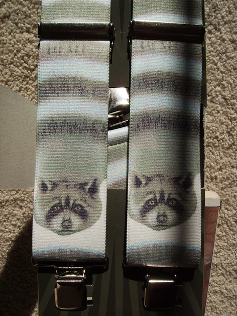 "WILDLIFE RACCOON 1 1/2""X48""  Suspenders with 4 strong 1""x 1"" Stainless Steel Grips and 2 Secure Stainless Steel Length Adjusters in the front.   Entirely Stretchable Hand Washable and Hang to Dry Cotton/Polyester Material.           UB220N48WLRC"