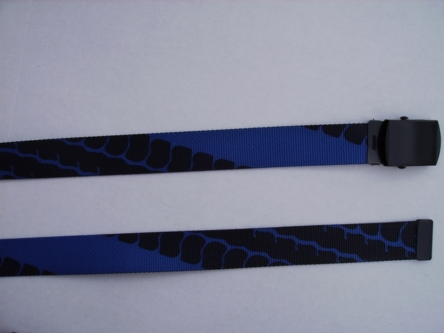 "TIRE TREAD ROYAL BLUE  -  High Quality U.S. Made Cotton/Polyester Non-Stretching Material with Solid Belt Buckle. These will fit  all size waists from 8"" up to 48""  by un-clamping Buckle and cutting off extra material on non-metal end. Then just re-clamp Material.   BELT-UB220N48TTRO"