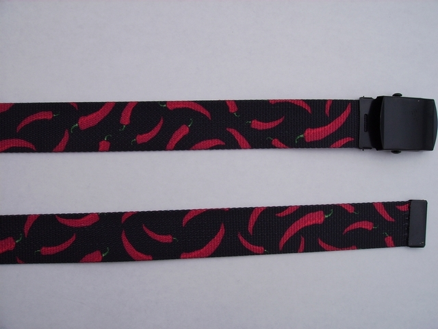 "RED CHILI PEPPERS ON BLACK -  High Quality U.S. Made Cotton/Polyester Non-Stretching Material with Solid Belt Buckle. These will fit  all size waists from 8"" up to 48""  by un-clamping Buckle and cutting off extra material on non-metal end. Then just re-clamp Material.   BELT-UA220N48LEAF"