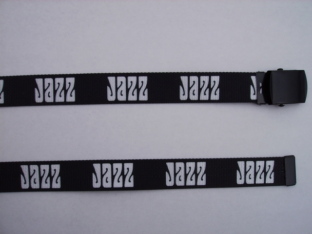 "JAZZ GREY LETTERS ON BLACK -  High Quality U.S. Made Cotton/Polyester Non-Stretching Material with Solid Belt Buckle. These will fit  all size waists from 8"" up to 48""  by un-clamping Buckle and cutting off extra material on non-metal end. Then just re-clamp Material.   BELT- UA220N48JZGY"