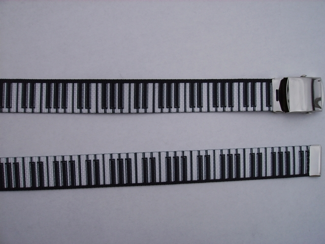 "PIANO WHITE KEYS ON BLACK -  High Quality U.S. Made Cotton/Polyester Non-Stretching Material with Solid Belt Buckle. These will fit  all size waists from 8"" up to 48""  by un-clamping Buckle and cutting off extra material on non-metal end. Then just re-clamp Material.    BELT-UB220N48PIBK"