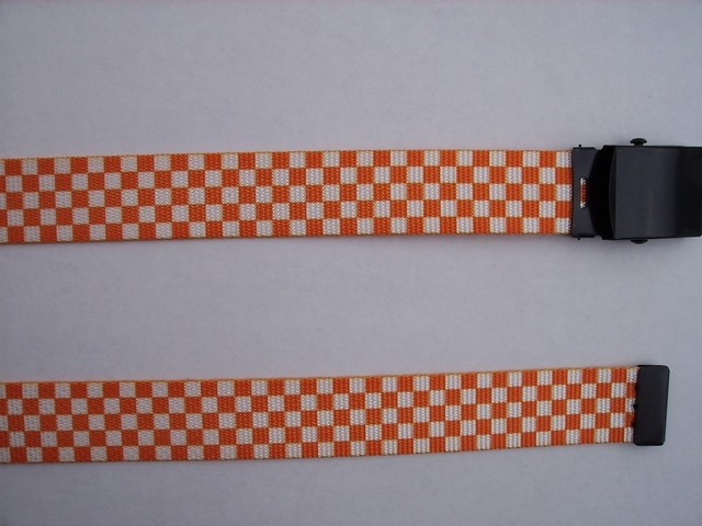 "CHECKERS ORANGE AND WHITE - High Quality U.S. Made Cotton/Polyester Non-Stretching Material with Solid Belt Buckle. These will fit  all size waists from 8"" up to 48""  by un-clamping Buckle and cutting off extra material on non-metal end. Then just re-clamp Material.       BELT-220N48CKOW"
