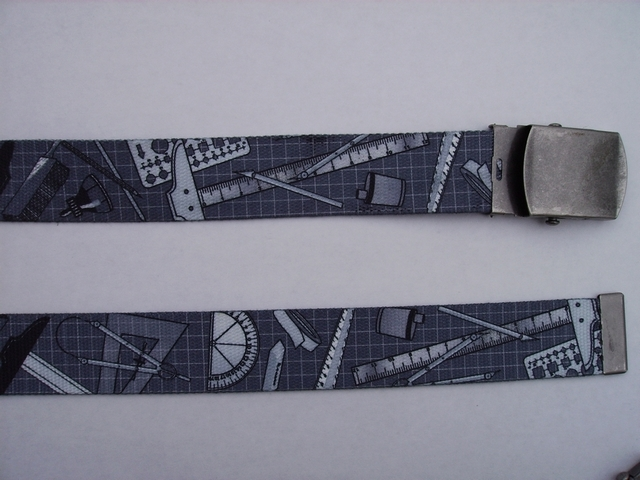 "DRAFTING TOOLS ON GREY GRID -  High Quality U.S. Made Cotton/Polyester Non-Stretching Material with Solid Belt Buckle. These will fit  all size waists from 8"" up to 48""  by un-clamping Buckle and cutting off extra material on non-metal end. Then just re-clamp Material.      BELT-UB220N48DTGG"