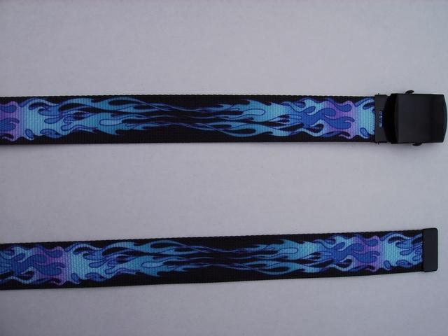 "BLUE FLAMES ON BLACK  - High Quality U.S. Made Cotton/Polyester Non-Stretching Material with Solid Belt Buckle. These Belts Are Sold by Us Wholesale in Large Quantities, to Name Brand Stores and Thye Resell Them at Premium Prices. These will fit  it will fit All Size Waists from 8"" up to 48""  by Un-Clamping Buckle and Cutting Off Extra Material on Non-Metal End. Then Just Re-Clamp Material.        BELT-UA220N48FLBL"
