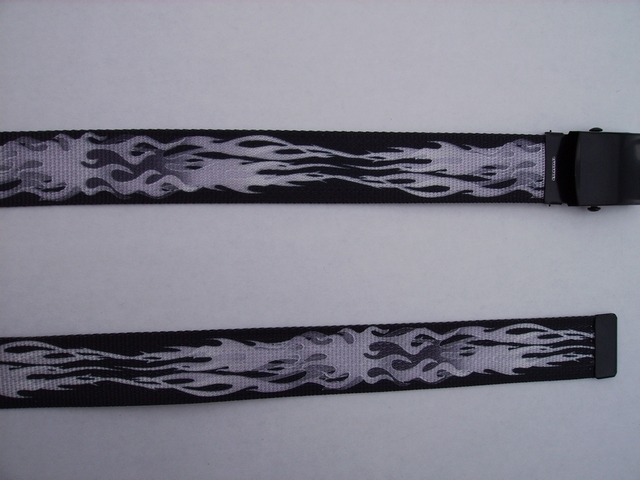 "FLAMES GREY ON BLACK - High Quality U.S. Made Cotton/Polyester Non-Stretching Material with Solid Belt Buckle. These will fit  all size waists from 8"" up to 48""  by un-clamping Buckle and cutting off extra material on non-metal end. Then just re-clamp Material.      BELT-UA250K48FLGY"