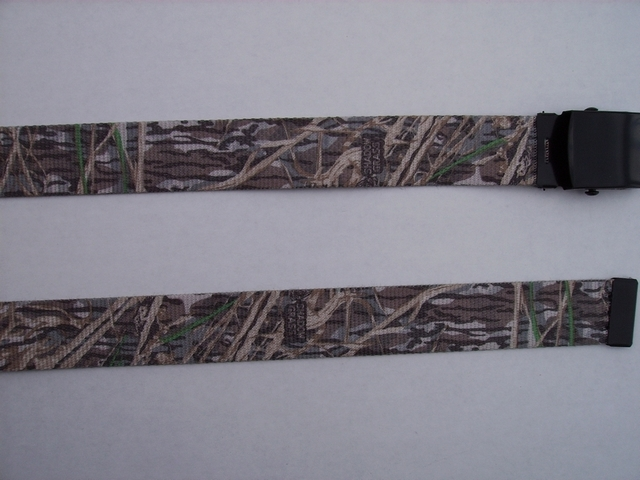 "LICENSED CAMOUFLAGE SHADOW GRASS -  High Quality U.S. Made Cotton/Polyester Non-Stretching Material with Solid Belt Buckle. These will fit  all size waists from 8"" up to 48""  by un-clamping Buckle and cutting off extra material on non-metal end. Then just re-clamp Material.     BELT-UA250K48SHAD"