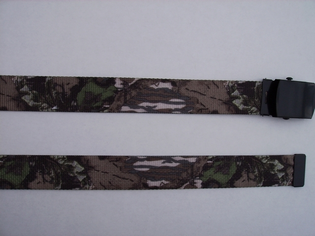 "LICENSED CAMOUFLAGE BREAKUP -  High Quality U.S. Made Cotton/Polyester Non-Stretching Material with Solid Belt Buckle. These will fit  all size waists from 8"" up to 48""  by un-clamping Buckle and cutting off extra material on non-metal end. Then just re-clamp Material.     BELT-UA260K48BREA"
