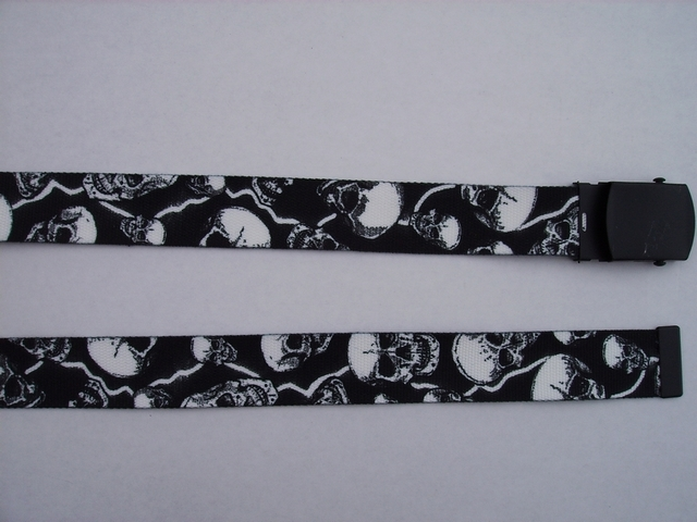 "SKULLS WITH LIGHTNING BOLTS - High Quality U.S. Made Cotton/Polyester Non-Stretching Material with Solid Belt Buckle. These will fit  all size waists from 8"" up to 48""  by un-clamping Buckle and cutting off extra material on non-metal end. Then just re-clamp Material.      BELT-UB220K48LIGH"