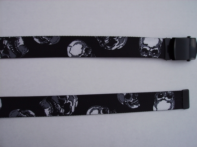 "SKULLS  WHITE SKULLS ON BLACK - High Quality U.S. Made Cotton/Polyester Non-Stretching Material with Solid Belt Buckle. These will fit  all size waists from 8"" up to 48""  by un-clamping Buckle and cutting off extra material on non-metal end. Then just re-clamp Material.    BELT-UA250K48SKULL"